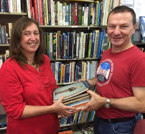 Graham Perrett MP helps hand over some of our book donations
